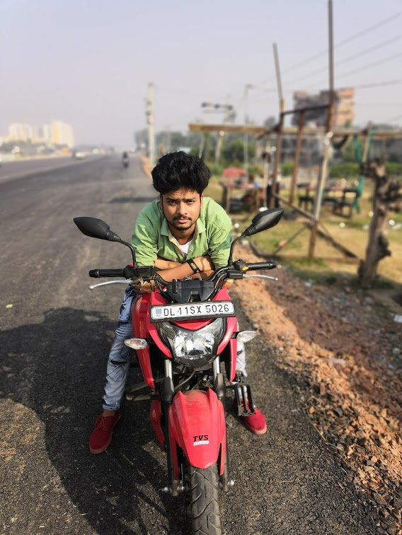 Ravi Dixit with Bike